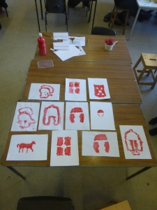 Stencil way-marks for the 'Romans to the Races' heritage trail by pupils from Glyn Derw High School