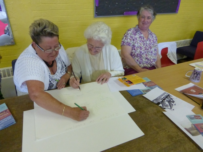 Banner design workshop with the Healthy, Wealthy and Wise group.