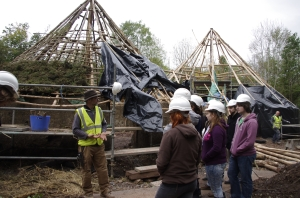 John explains all about the Thatching process with the massivce roundhouses in the background
