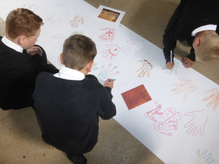 Decorating our cave-art 'hand stencils' ...