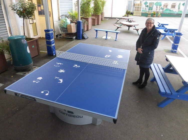 Jane Holland, Assistant Head Teacher at Woodlands with the completed 'Romanbritish' table tennis table.
