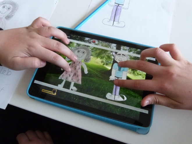 Characters designed by the young people are scanned into the iPad to help create animation sequences.