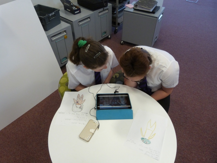 Working in pairs, the young people record their animation sequences in pairs.