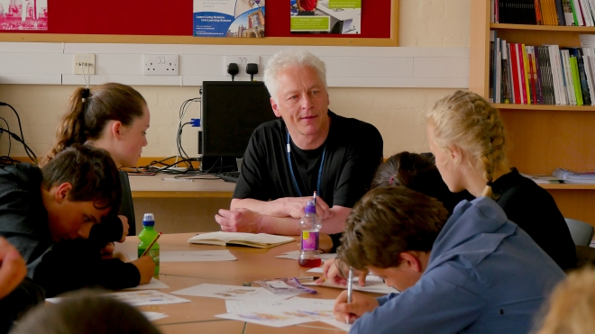 The young people needed very little encouragement to develop some amazing characters and scripts - lead artist Paul Evans enjoying the workshop ...